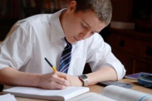 boy studying and writing
