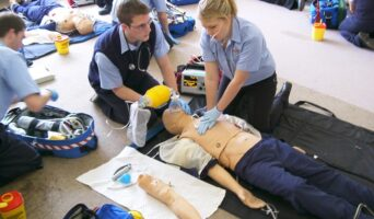 future EMTs training with a mannequin