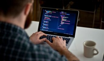 Man taking one of the best online coding courses