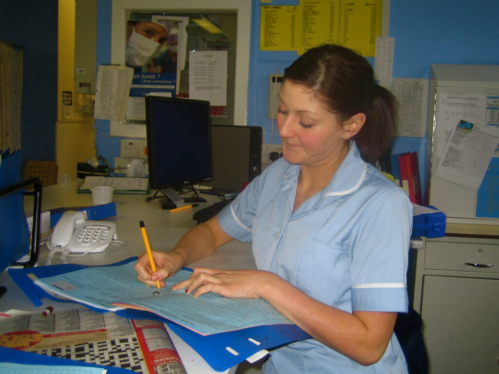 female nurse writing on paper
