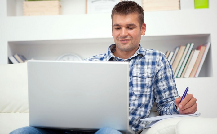 man using laptop to learn