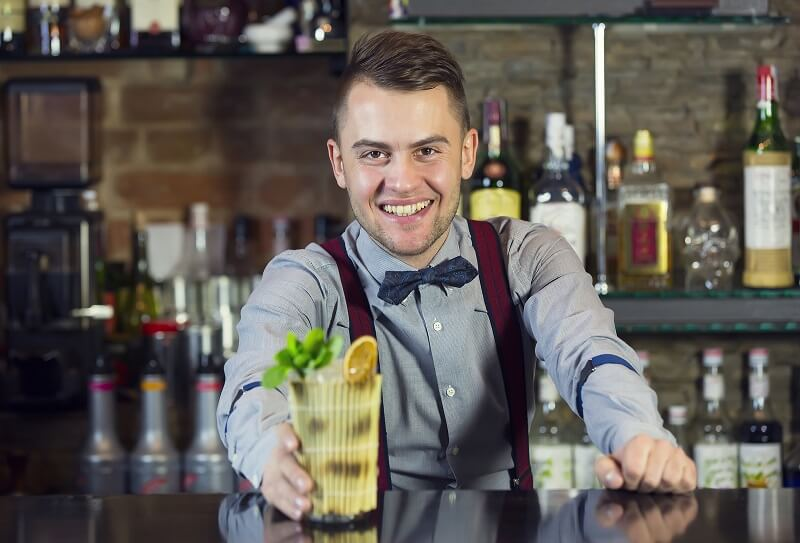 bartender serving a cocktail