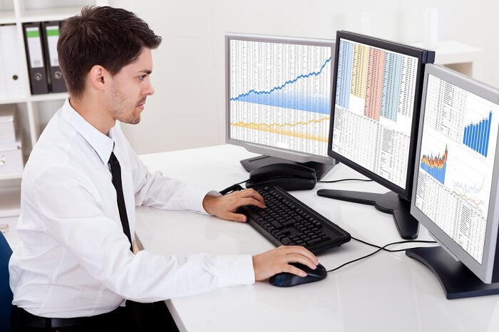 financial analyst at his computer