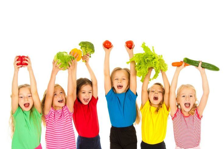 kids holding veggies