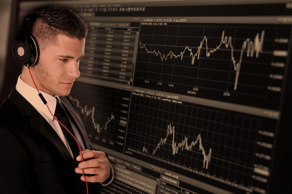 Businessman monitoring stocks