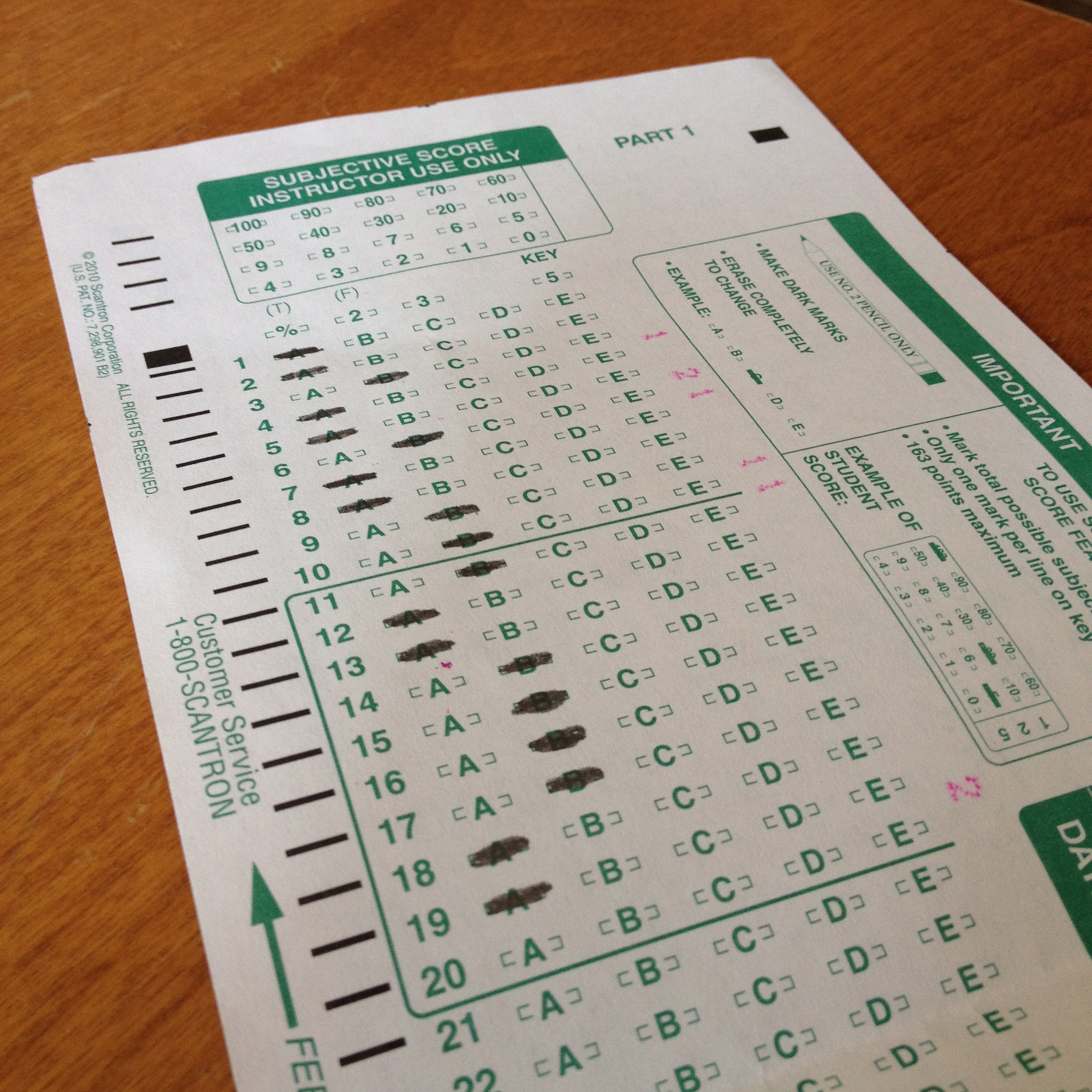 green and white scantron sheet