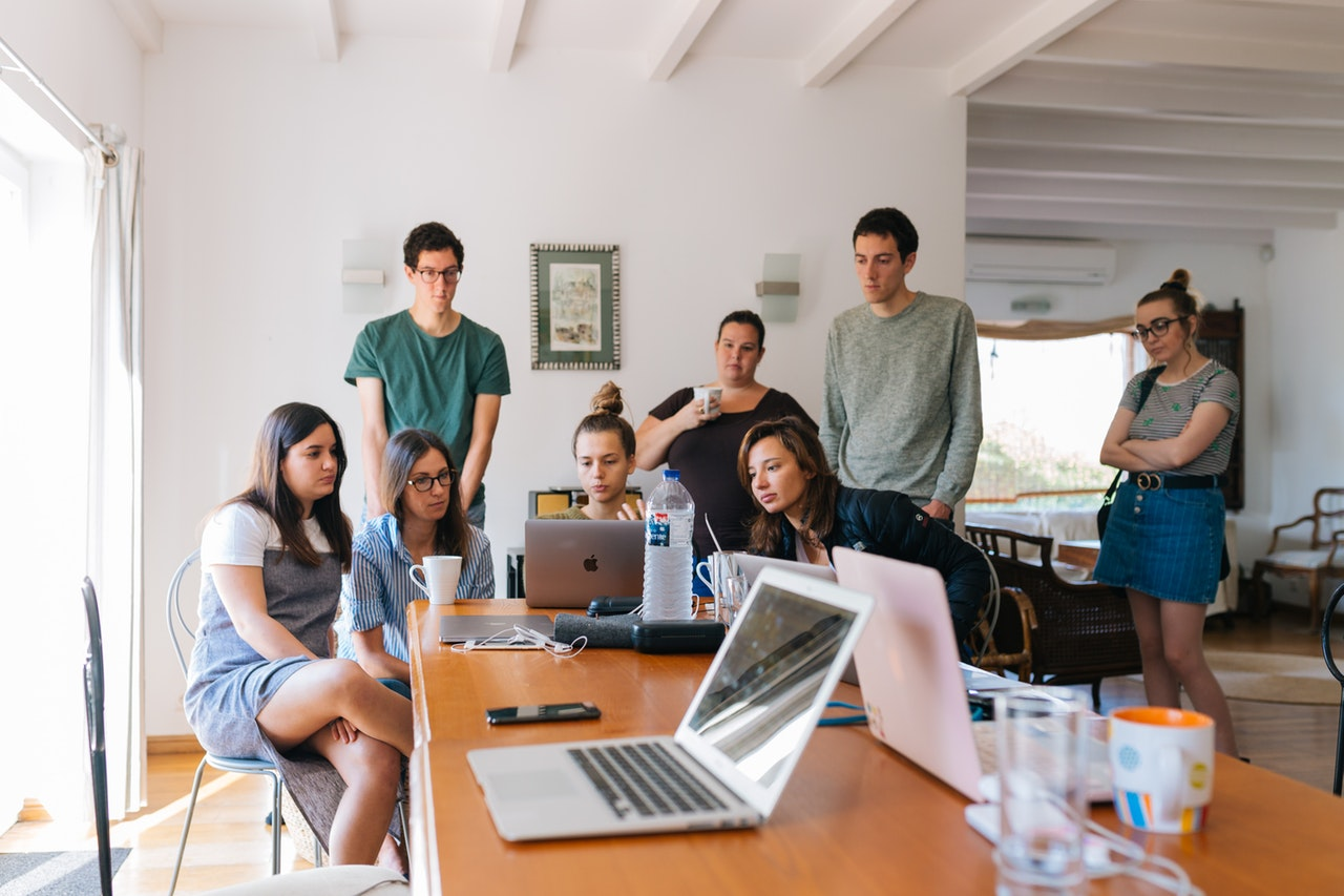 a group of students attending an online course on one laptop