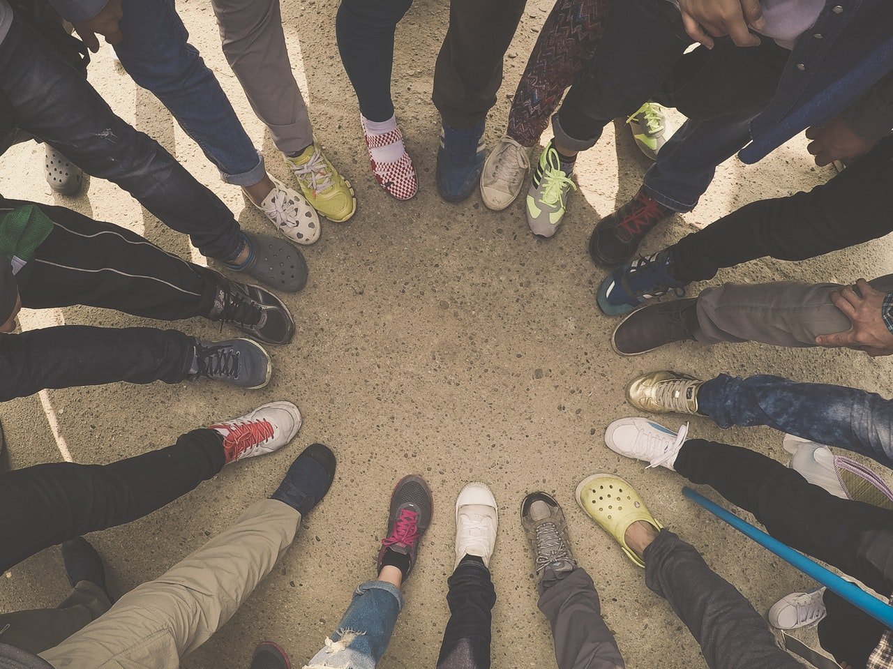 circle of feet of students wearing different types of shoes